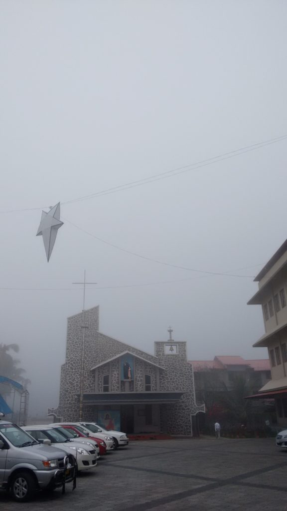 Misty Christmas morning at a church in Kalpetta