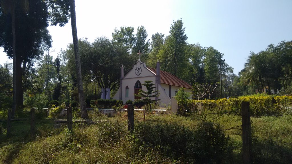 A small church with a garden around it